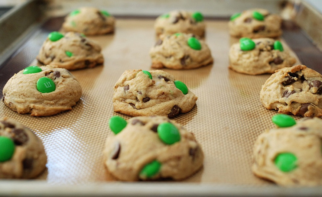 chocolate chip cookies with MMs on baking sheet
